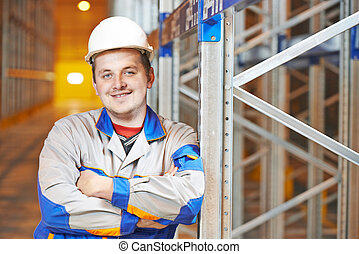 warehouse worker in storehouse - young smiling warehouse...