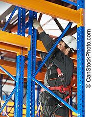 warehouse worker installing rack arrangement