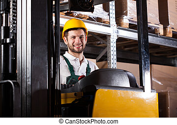 Warehouse worker on forklift