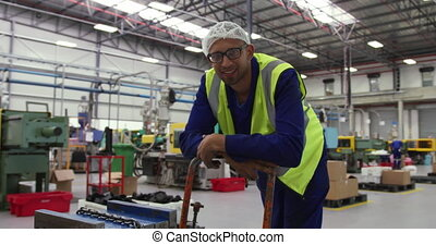 Warehouse worker smiling and looking at camera - Front view ...