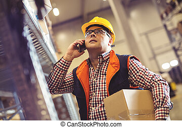 Warehouse worker talking on the phone