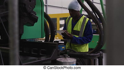 Warehouse worker using a digital tablet