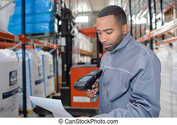 Warehouse worker using handheld scanner