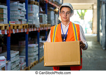 Warehouse worker with a box in his hands