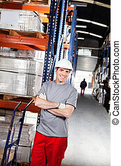 Warehouse Worker With Handtruck At Warehouse