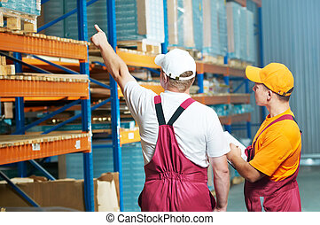 warehouse workers at storehouse - warehouse workers men...