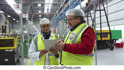 Warehouse workers discussing together - Front view of a ...