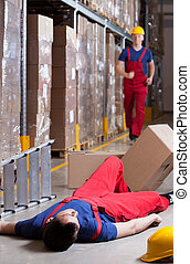 Warehouseman after accident at height - Vertical view of a ...