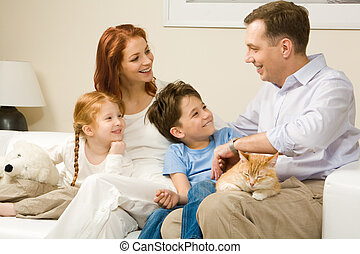 Warm atmosphere - Friendly family members sitting on ...