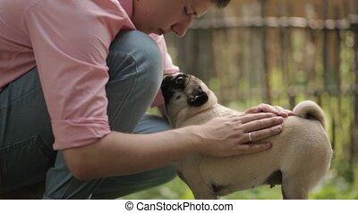 Warm attitude man dog - Guy stroking dog she starts sniffing...