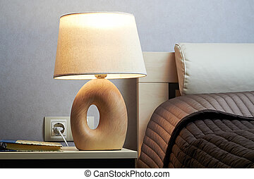 warm bedroom with lamp on a  night table
