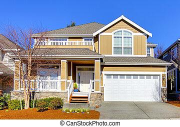 Warm beige house with spring landscape.