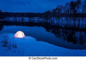 Warm camping in the winter at the lake