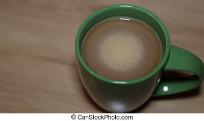 Warm cappuccino with foam in a green cup - Cappuccino with...