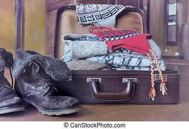 ec7ab85f9c2 Suitcase full of warm clothes. Small suitcase filled ajar and warm ...