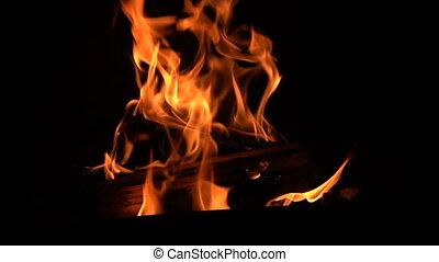 Warm cozy burning fire in the fireplace. - Warm cozy burning...