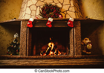 Warm cozy fireplace decorated for Christmas with real wood burni