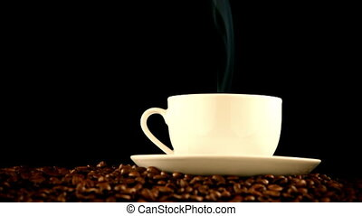 warm cup of coffee on black