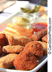 Warm fried snacks, served with mayonnaise, mustard and ...