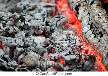warm glowing embers with gray ash and coals