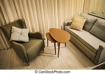 Warm living room with couch, arm chair and coffee modular...