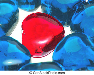 warm love in cold world - macro of glass hearts