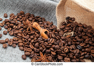 warm roasted coffee beans on burlap and close up - roasted ...