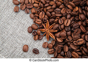 warm roasted coffee beans on burlap top view - roasted ...
