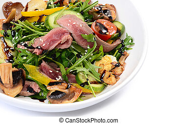 Warm salad with cutting of a lamb