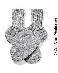 Warm Socks - Hand-knitted warm wool socks isolated on white...