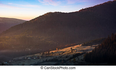 warm sunrise in mountainous countryside. beautiful autumnal...