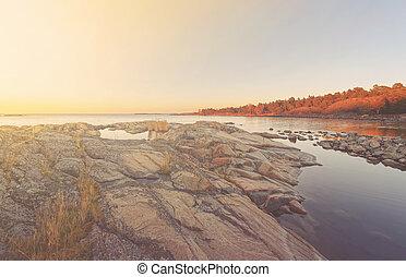 Warm sunrise over coast during autumn