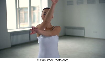 Warm Up - Bald woman twisting her arms and bending in eagle...