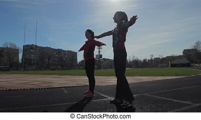 Warm up exercise - Young girls spend training exercises...