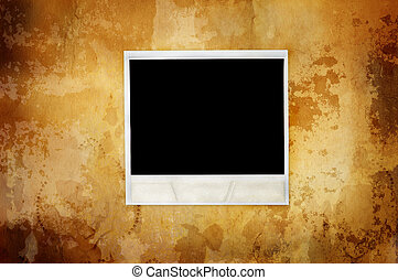 warm vintage background with empty polaroid