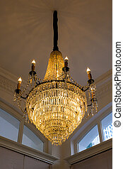 Warm white chandelier or lamp with ceiling in the hall
