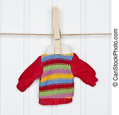 Warm Winter Striped Sweater on a Clothesline