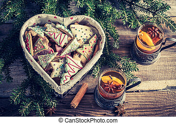 Warming tea with cinnamon and sweet cookies for Christmas