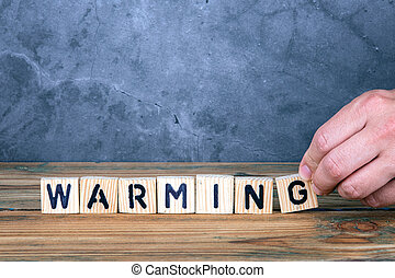Warming - word from wooden letters