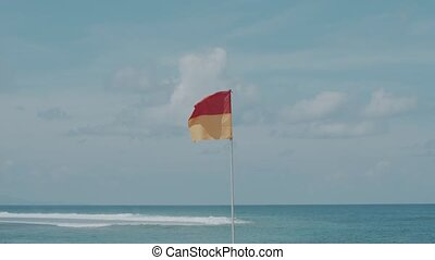 Warning flag on the beach - Red and yellow warning flag on...