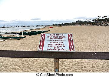 warning for barefoot and high Heels at the pier in Santa Barbara