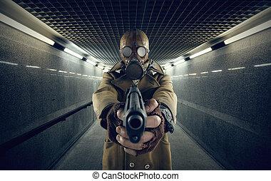 warning - grunge portrait man in gas mask pointing a gun