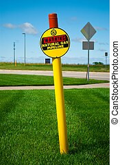 warning - Natural Gas pipeline sign on a sunny day