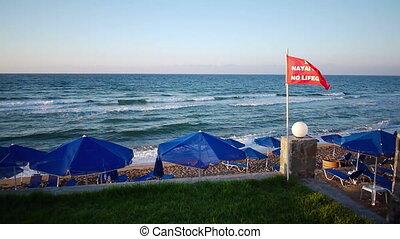 Warning No Lifeguard sign at the be