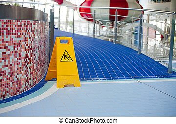 Warning of slippery floors. - Information signs indicating...