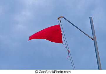 Warning red flag - Red flag signalling a danger at sea