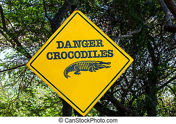 Warning sign at the Estuary Boardwalk of the San Lucia River