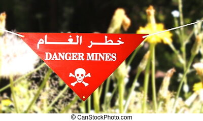 warning sign before a mine field - warning sign in front of...