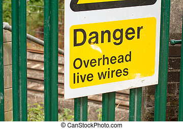 Warning sign of live wires on the railway track