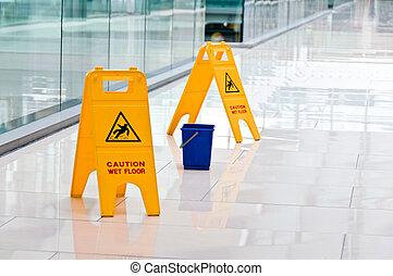 Warning sign slippery, A yellow warning. Floor